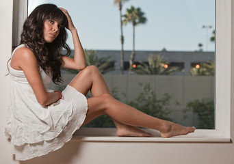 Attractive twenties hispanic brunette woman relaxing lifestyle