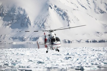 Helicopter over the frozen fjord