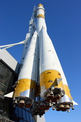 Three-stage space rocket against a blue sky