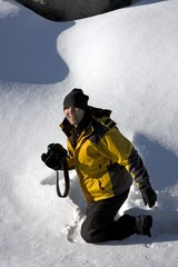 Woman In The Snow with Camera, Alberta, Canada
