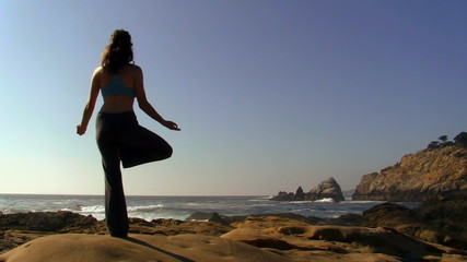 Yoga balancing pose by the ocean - HD