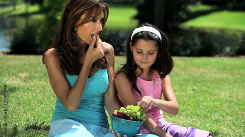 Mother and daughter sharing healthy eating