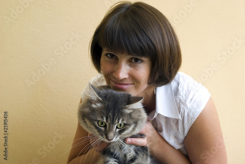 Woman with cat, close up