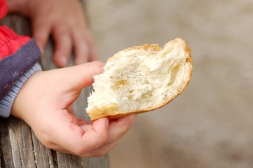 hand with piece of bread