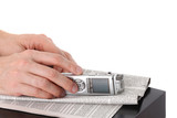 Dictaphone in male hand and newspaper