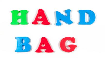 hand bag written in fridge magnets