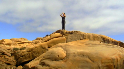 Practicing yoga on rock - HD