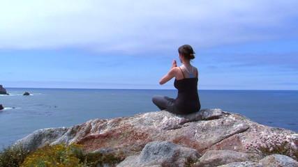 Yoga lotus pose by the sea - HD
