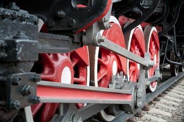 Old steam engine wheels close-up