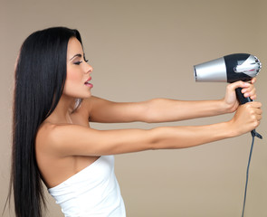 Portrait of beautiful woman, she holding hair dryer