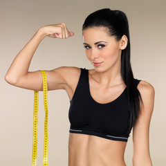 Young beautiful woman after fitness time and exercising