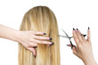 Woman with blond hair and hairdresser's scissors