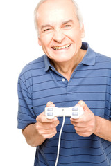 Happy old man playing video games