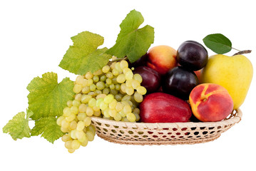 ripe, juicy apples, grapes, nectarines plums in a wicker basket