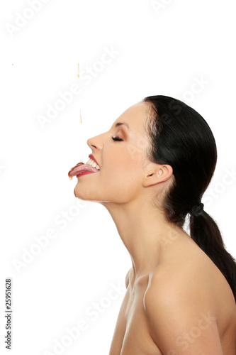 Woman eating strawberry sauce