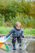 Boy jumping in puddle