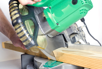 using a miter saw to make a compound cut through lumber