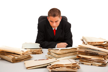 Man looking at lots of documents