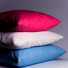 pink, white and blue pillows