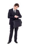 Fototapety businessman checking watch on white