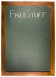 Free Stuff text on green chalk board