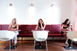 Three lone women in restaurant