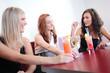 Three young women having fun in restaurant