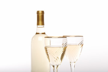 Closeup of white wine bottle and luxury glasses