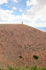 the  man on top of a hill