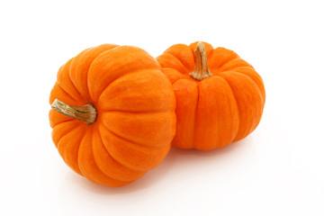 Orange Gourds Stacked Over White
