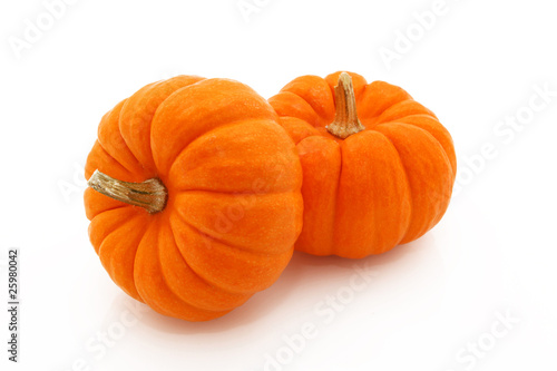 Orange Gourds Stacked Over White