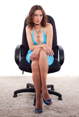 Cute, sexy girl in an office chair.