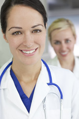 Attractive Brunette Woman Doctor With Stethoscope