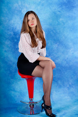 Girl sitting on chair and posing