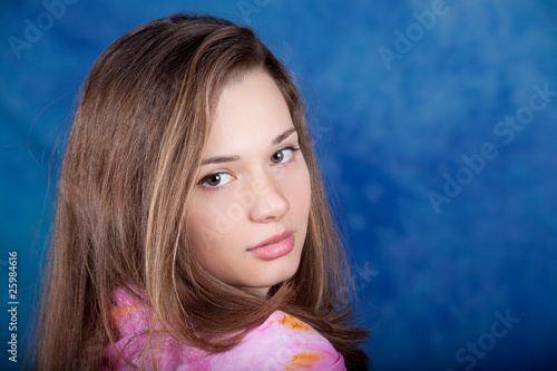 Young woman posing on a blue background