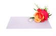 Red rose, diamond ring, letter