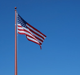 U.S. Flag against a clear blue sky
