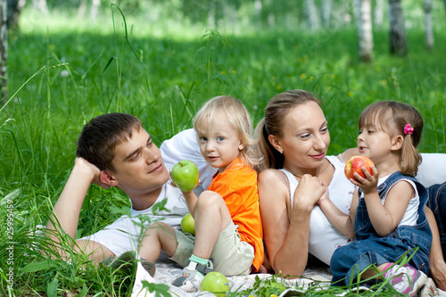 Happy family in park having picnic