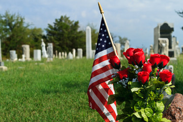 American Flag and in old graveyard