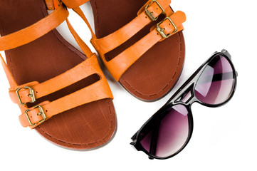 Fashion women sandals and sun glasses isolated on white