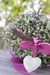 Beautiful basket with a stone heart and heather
