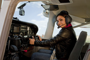 Woman in airplane cockpit