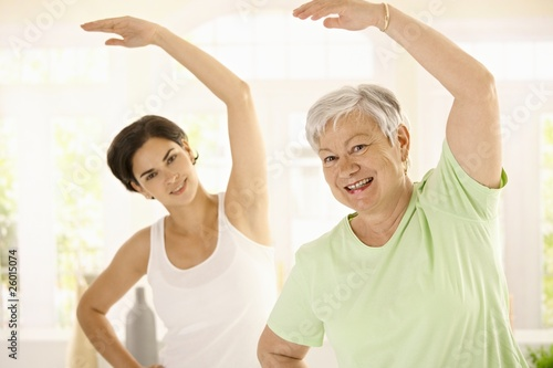Elderly woman with personal fitness trainer