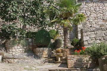 Garden in Hum the smallest city, Istra, Croatia