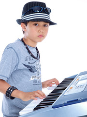 child playing music keyboard isolated on white background