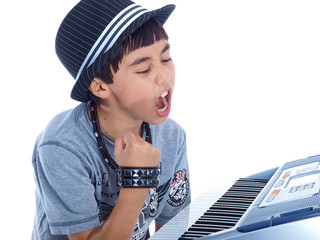 angry child yelling at his keyboard isolated on white