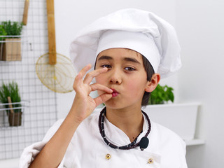 cook kissing his fingers showing tasty food is served