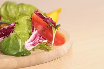 Salad on wooden board