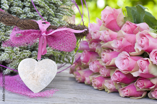 Beautiful roses with pink bow and white heather
