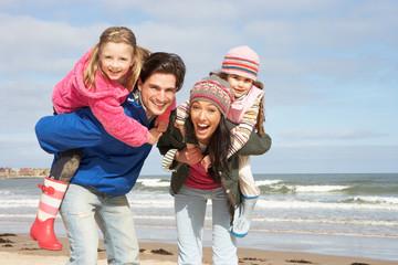 Family Walking Along Winter Beach